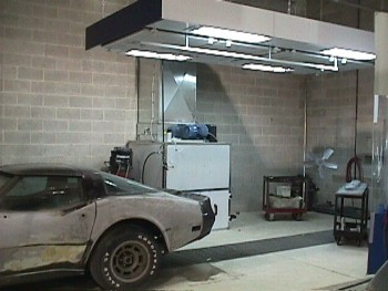 All airborne particles are pulled to the floor through a downdraft Accudraft ventilator. This uses the same filtration and lighting that the spray booth uses and is fully OSHA compliant. A movable curtain wall makes for easy access. This equipment keeps our employees safe and our shop virtually dust free.