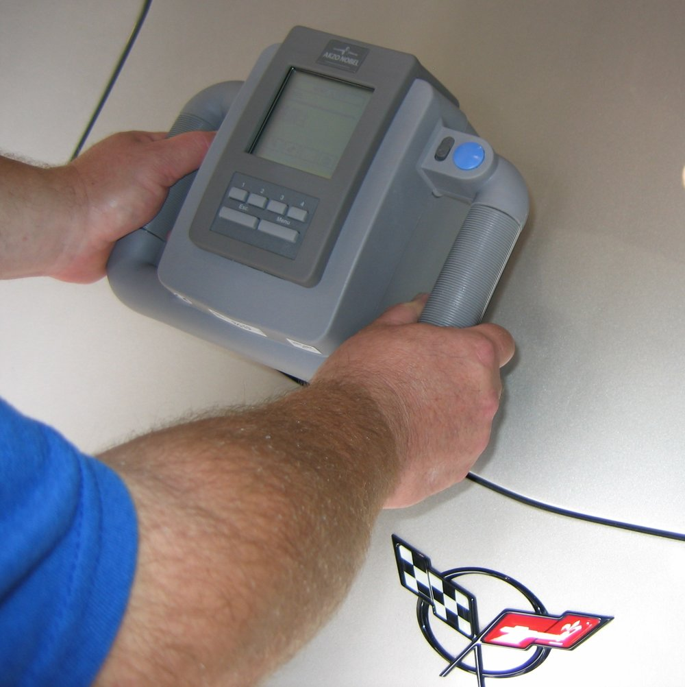 """Custom or non factory colors are matched using our in house camera, """"the AQUIRE RX"""" that actually identifies the colors on an existing finish and transmits that data to the formula retrieval system which then adjusts the color to a precise formula for mixing. Although this technology has existed foryears, Dupont has been a pioneer with advancing the accuracy of these units. Previous models only identify 6 paint angles while this unit will identify over 12 and the only system that adjusts the formula versus matching it to a """"close"""" variant.. Having this truly state of the art equipment in house really gives us a distinct advantage over virtually all other shops saving time and preventing multiple coats that have been applied in error."""