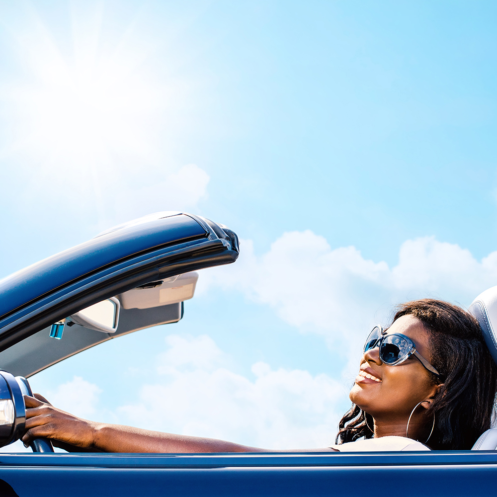 Woman in blue convertible