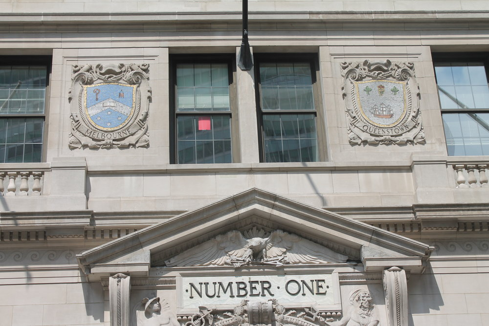 Entrance of One Broadway with seals of Melbourne and Queensland above