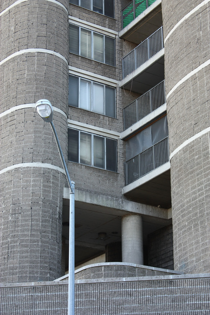Flat Windows and Balconies Between Cylindrical Columns