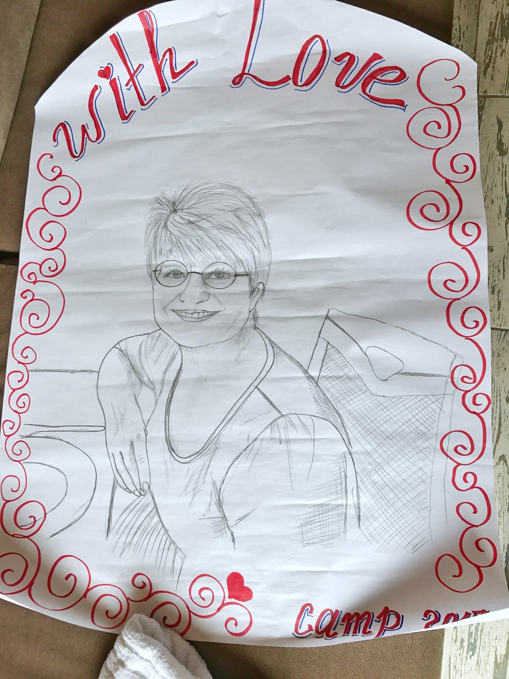The ladies presented us with gifts.....and one talented young lady even drew our portraits on a large poster. Wow!