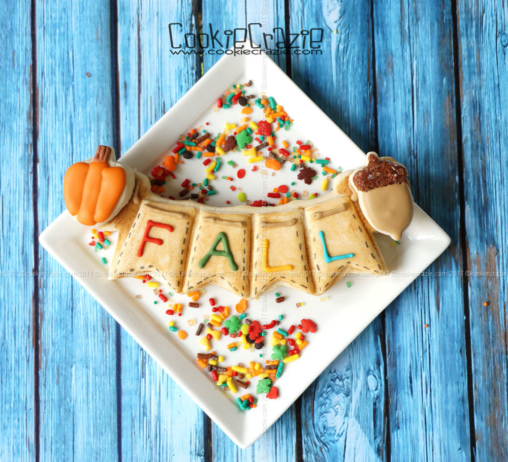 YouTube How To Video found  HERE  for Fall Bunting Decorated Sugar Cookie  Bunting (four spaces) Cutter  with mini pumpkin and acorn cookies added to the sides