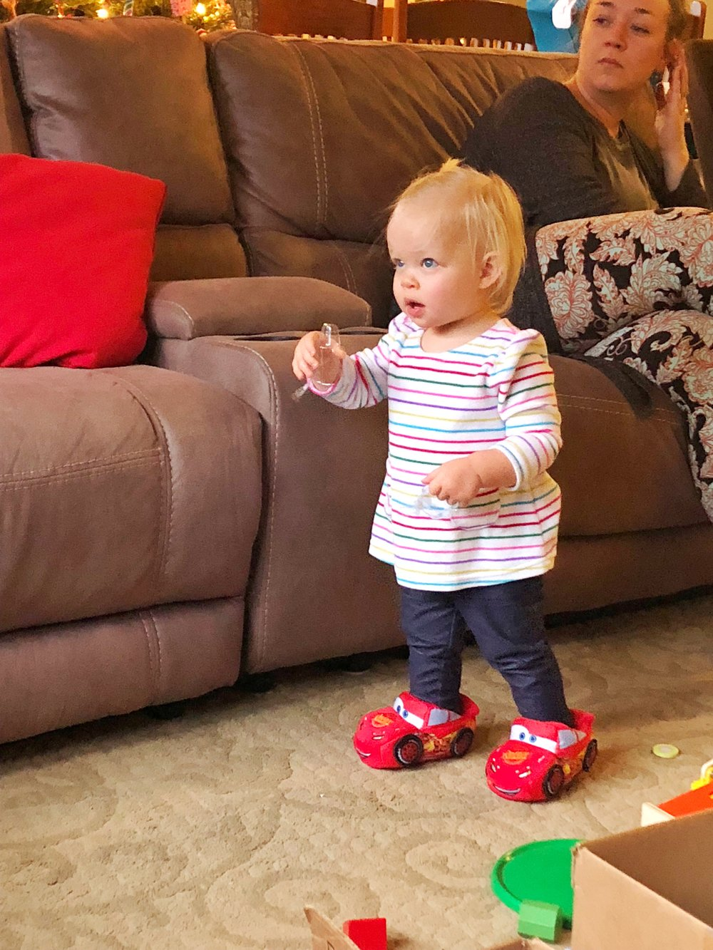 Finn was kind enough to allow Emmy to try out his Lightening McQueen slippers. :)