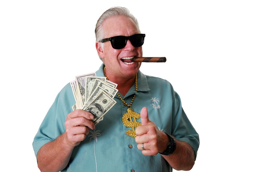 A man with money. A man wins money. A man has Money. A man Sniff
