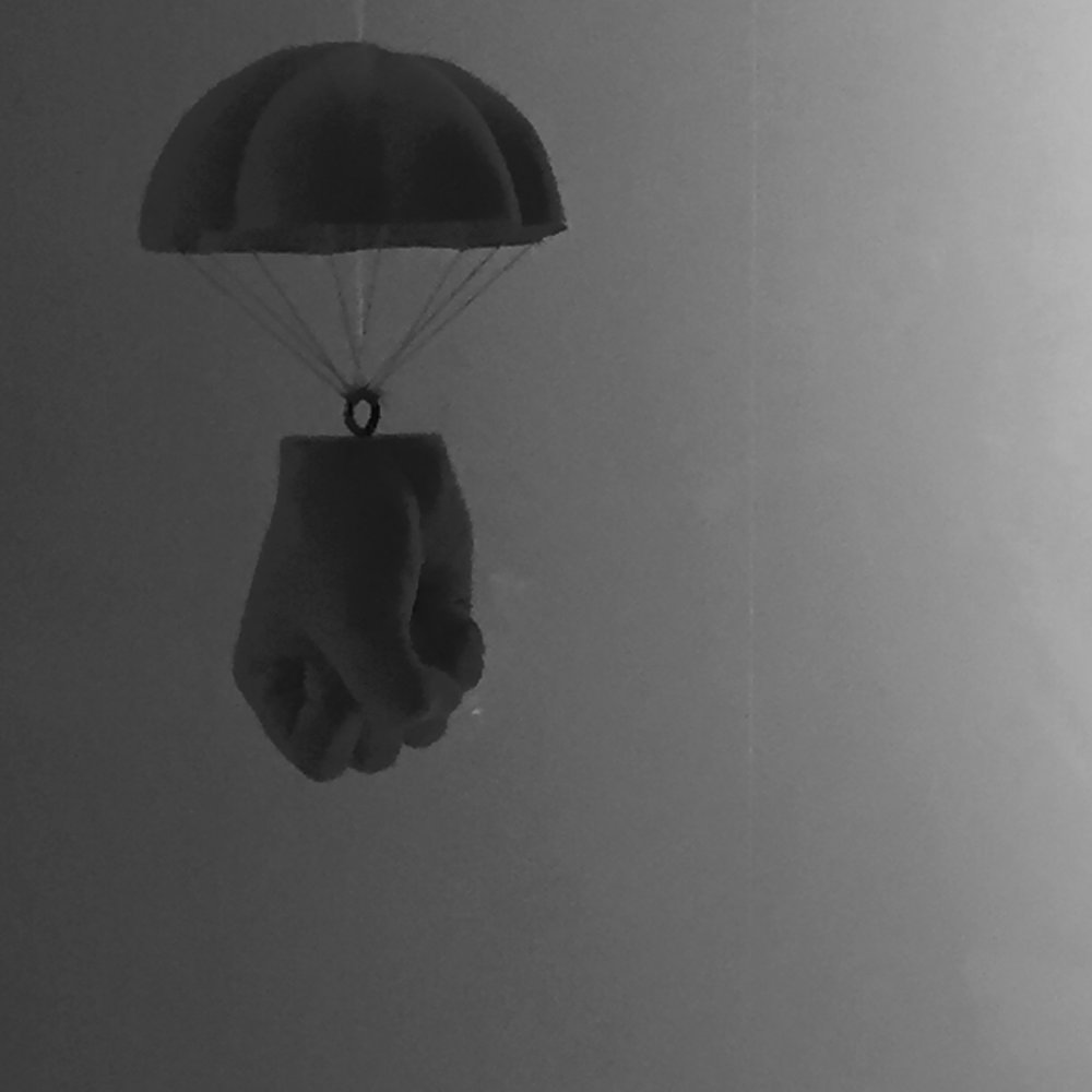 IMG_1660Abstract.BW.Handwithparachute.jpg