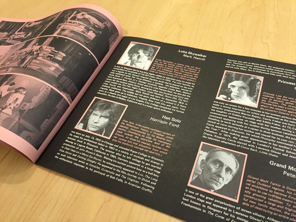 Cast and character bios from the second printing (note the pink hue).