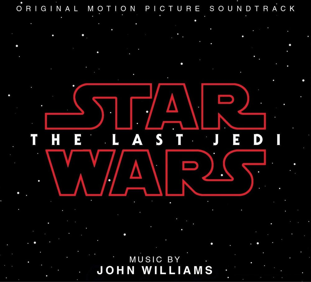"""- One of my biggest preliminary disappointments was the film's music. To be fair, John Williams' fantastic score for The Force Awakens would be difficult for The Last Jedi to match, let alone top. The multitude of memorable themes and motifs established in the Trilogy's first installment coupled with the new film's chaotic plot machinations didn't allow much room for a fresh musical throughline the way that The Force Awakens did. It's almost as if the score was grasping at the familiar for the sake of the potentially disoriented viewer. Rose's theme, while increasingly catchy and appropriately full of optimism, does not carry the weight of signature themes debuted in the previous films. Williams is also usually on point with his callbacks, but this film had two instances where reprises actually distracted rather than excited me. The repeated opening notes from Star Wars following the opening crawl and the use of the """"TIE Fighter Attack"""" cue during the Millennium Falcon's flight through the caves of Crait came across as somewhat tired. That said, the other musical mainstays were utilized to stirring and inspiring effect. Additional new pieces are beginning to stand out, particularly the Imperial March-derived cue in"""