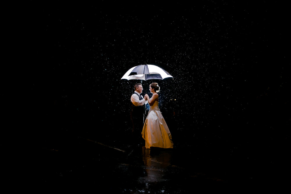 Did I mention I love rain on weddings? This was my wedding...just a little biased! Photo Credit: Jazi Photo