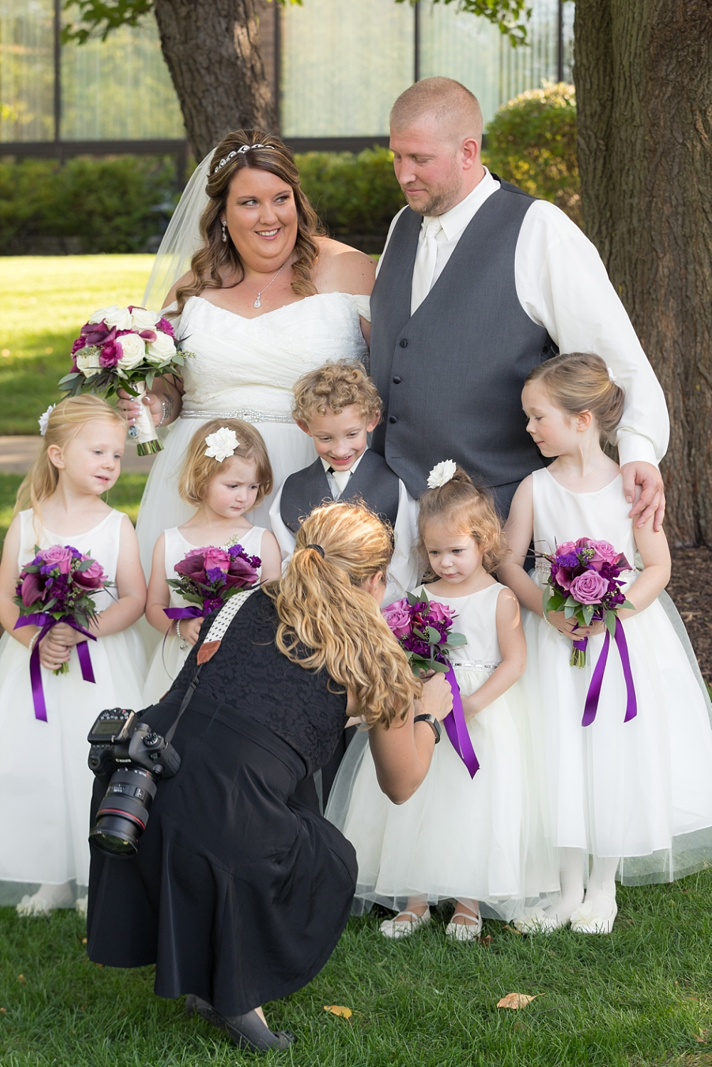 A good photographer makes sure everyone in the bridal party looks their best...including the littlest members.