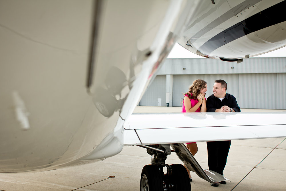 This is an example of doing something that speaks to you as a couple. My husband is an airline pilot, so we wanted to honor his profession in our engagement photos. We went to a private airport and were able to take photos with this Jet. Photo by: Authentic Adventure Co.