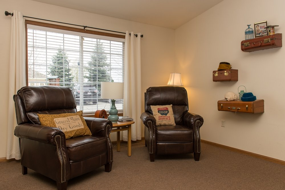 Two comfy armchairs inside a cozy seniors home