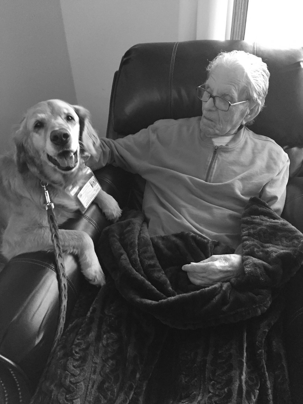 elderly resident and dog on an armchair