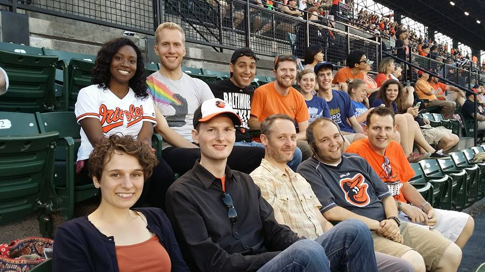Members of EEC Urbanites take-in an Orioles game.