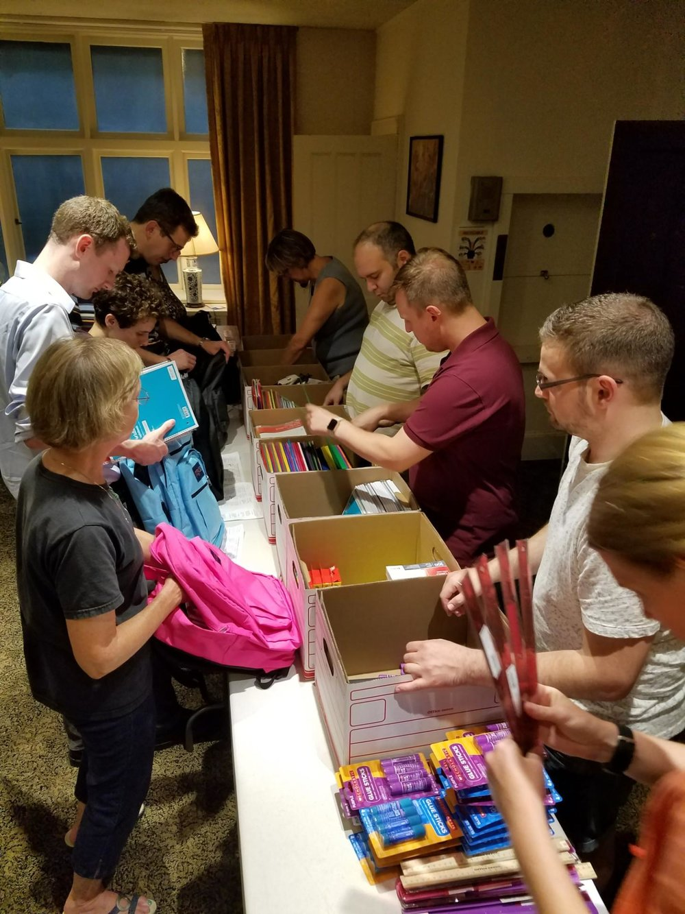 Packing book bags for area youth