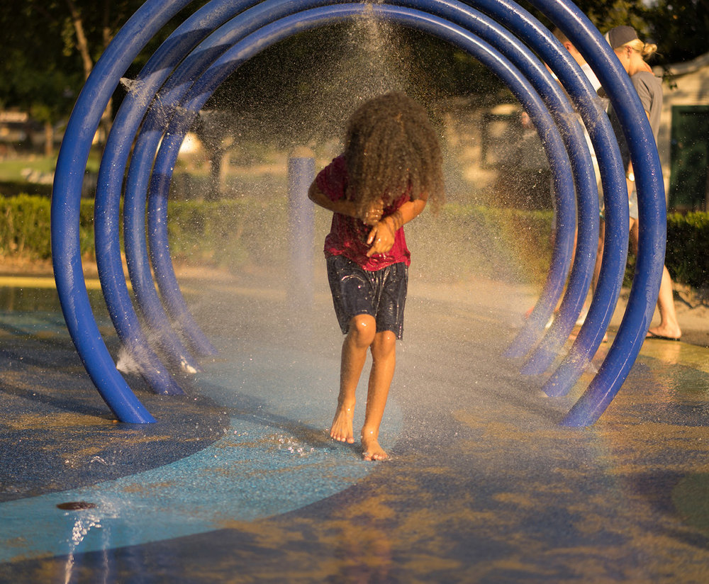 daughter plays in water at park-Danville Lifestyle Photography