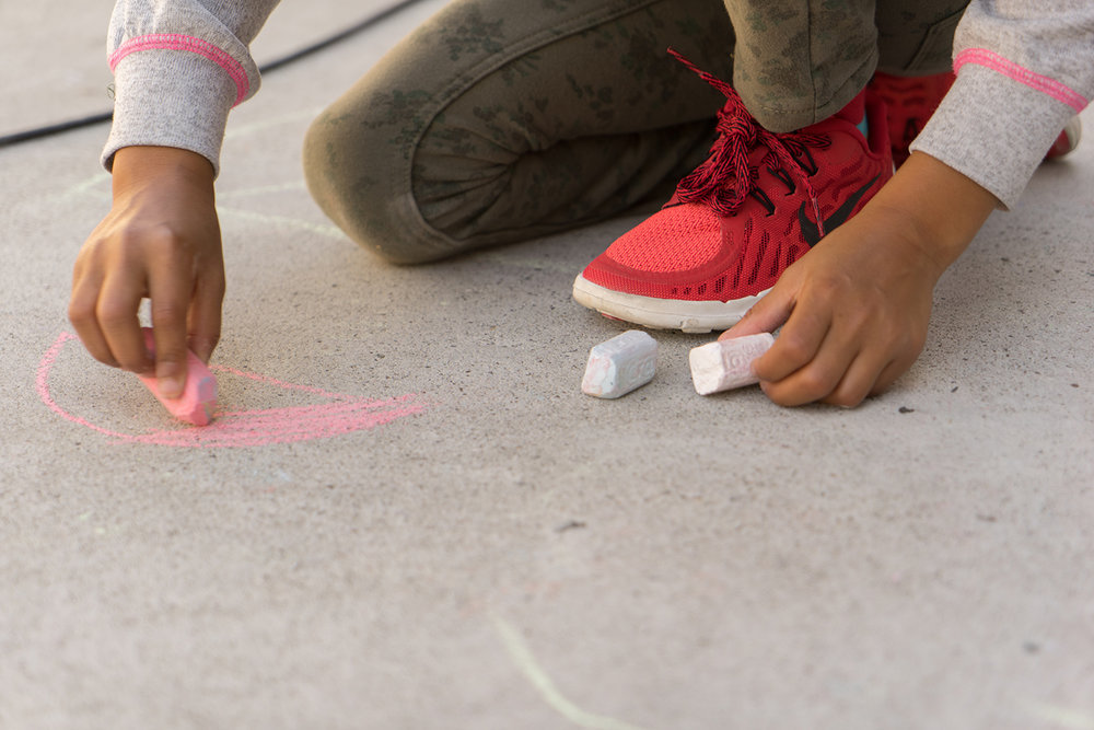 6 year old girl draws with chalk-SF East Bay children's photographer