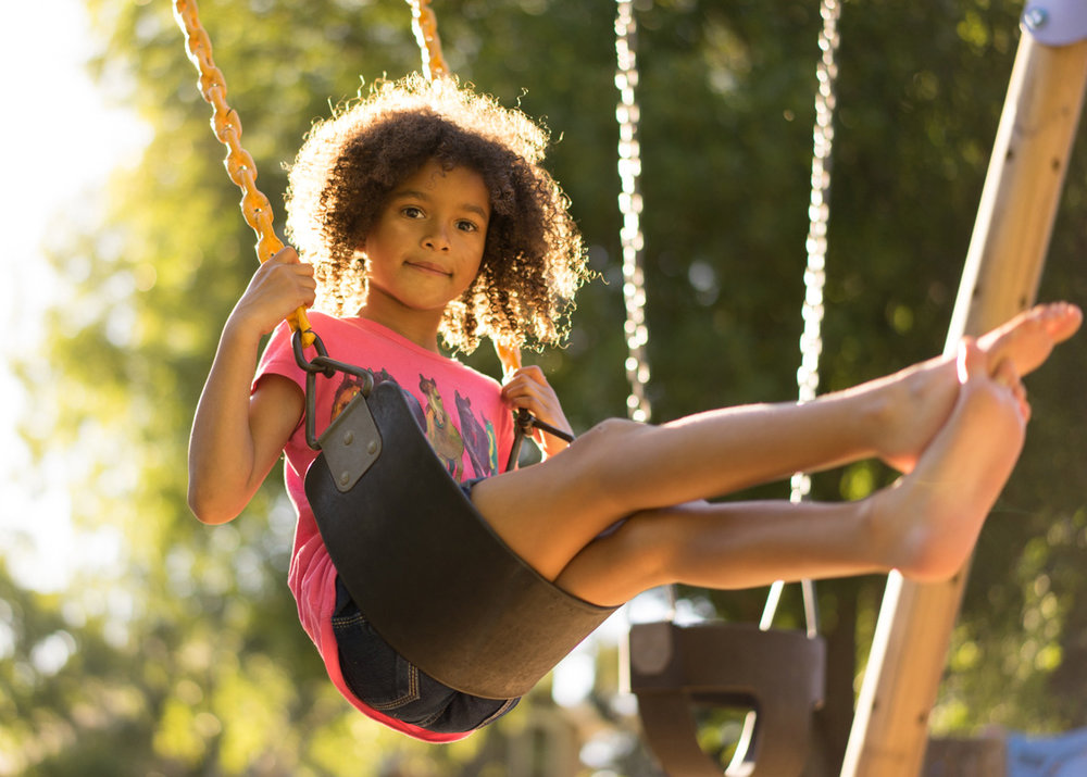 girl playing on swing-Danville family photographer