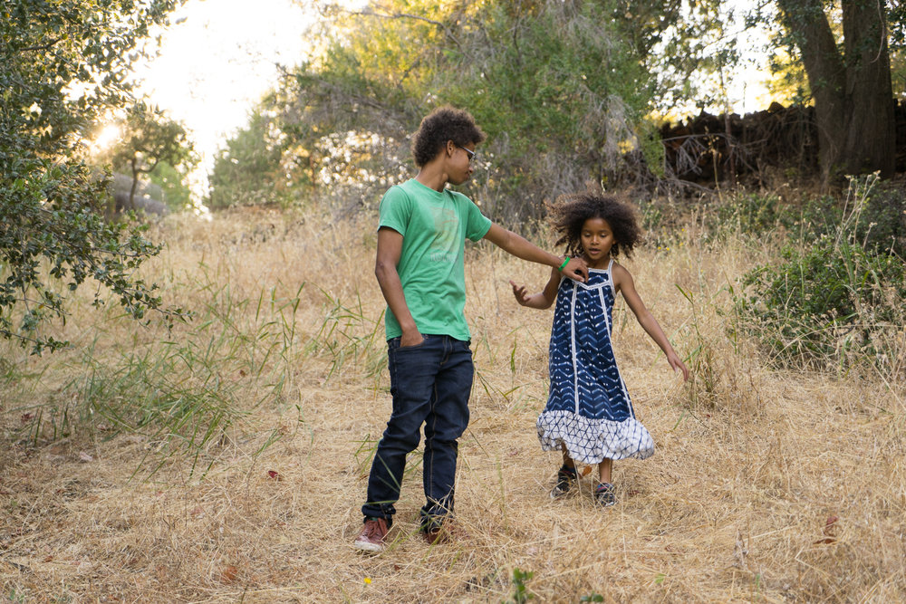 brother and sister in a field-Lafayette children's photographer