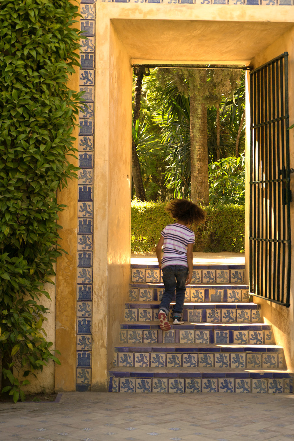 six year old girl running up the steps-fine art lifestyle photography
