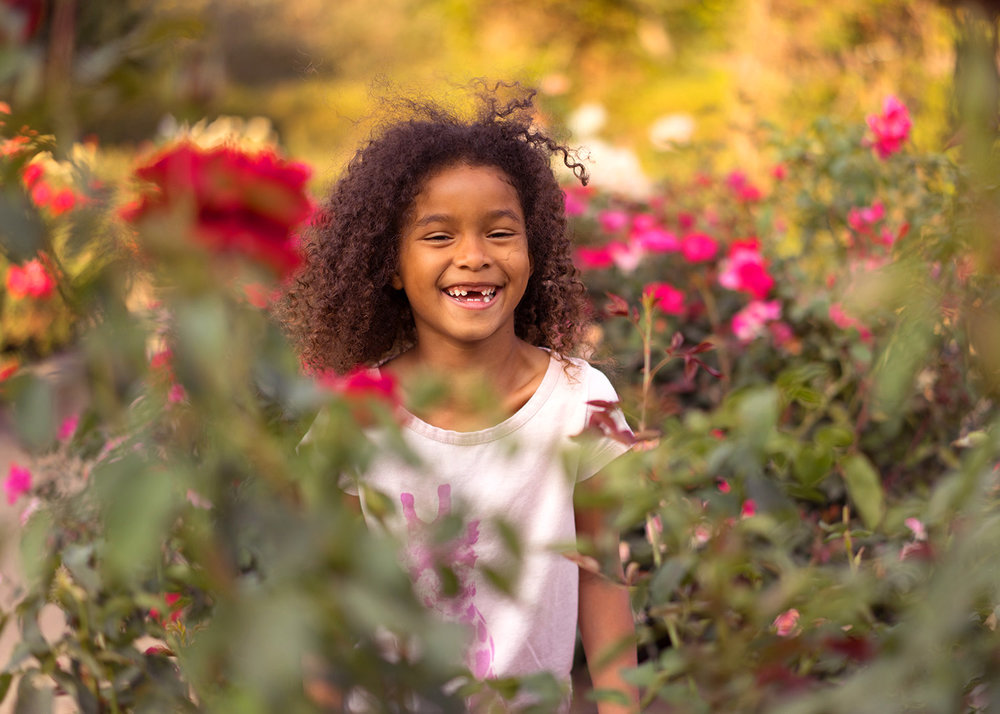 six year old girl in the garden-Danville children's photography
