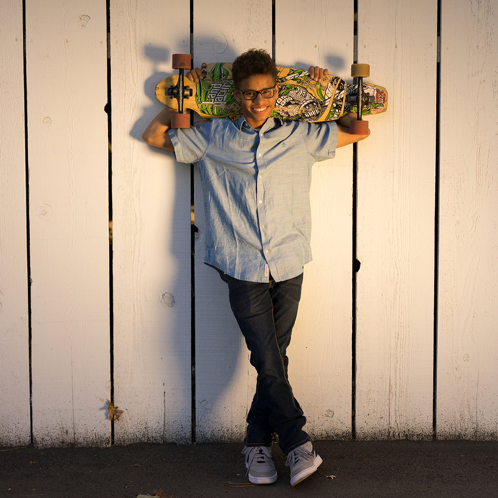 high school graduate with skateboard-Danville lifestyle photography