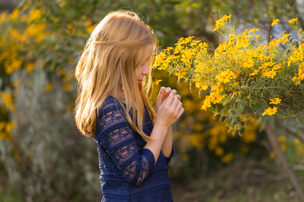10 year old girl with yellow flowers-Danville lifestyle photographer
