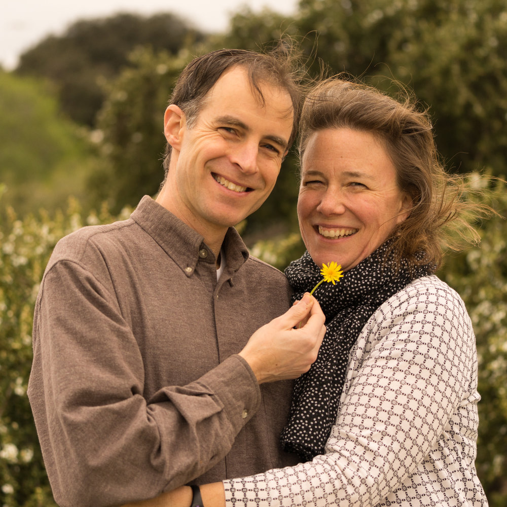smiling parents with flower-Oakland photography