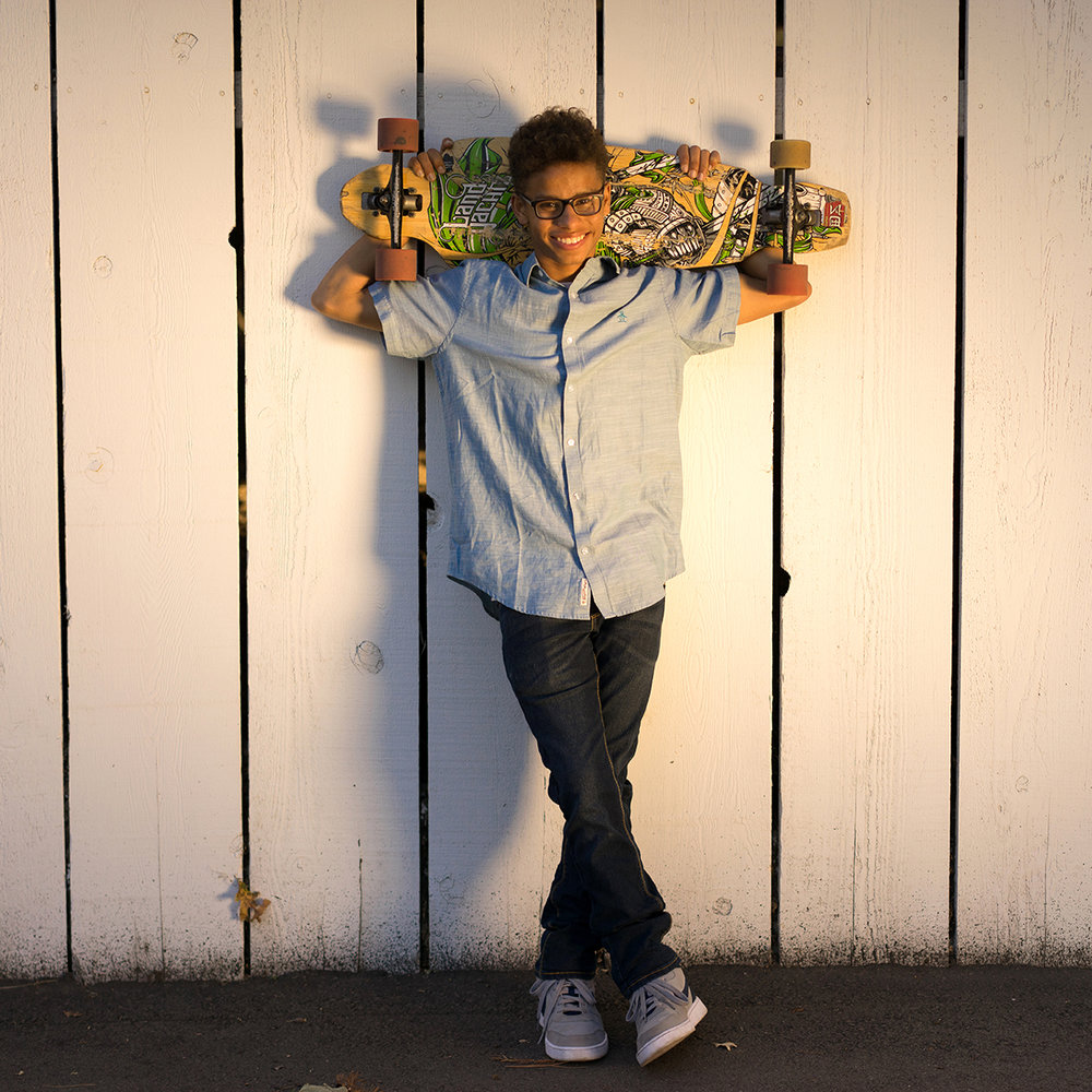 high school graduate with skateboard-Danville senior photographer