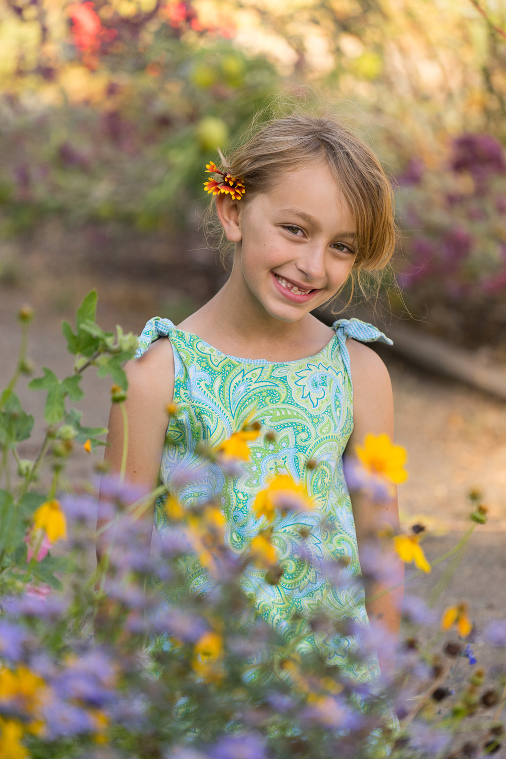 smiling girl with flowers - Lake Merritt Gardens - Oakland photographer
