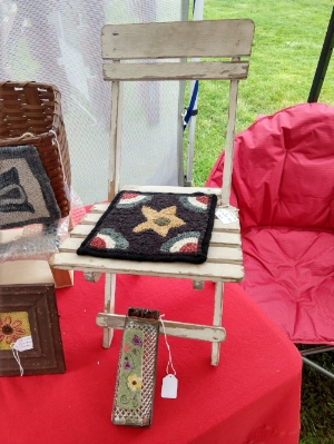 A child's beach chair with a star mat