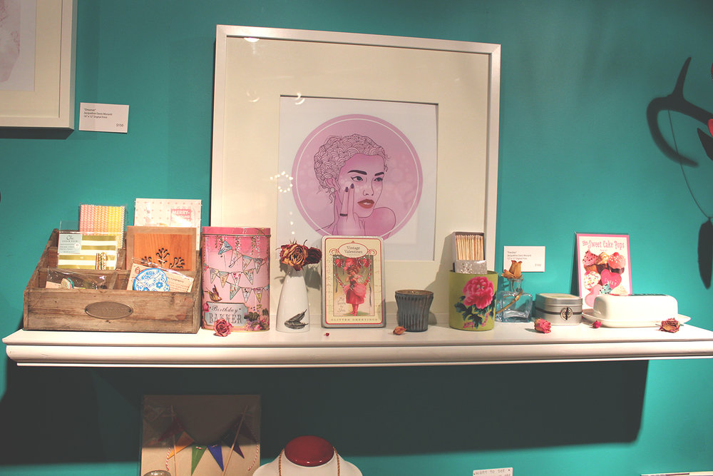 A shelf in Aoki Boutique with work from artist Jacqueline Davis Moranti.