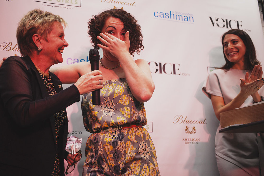 Educator of The Year Eileen R. Heisman brings presenter Lansie Sylvia to tears at The Rad Awards.  April 18. 2015. The Dreaming Building. Chris Fascenelli/Rad-Girls.com.