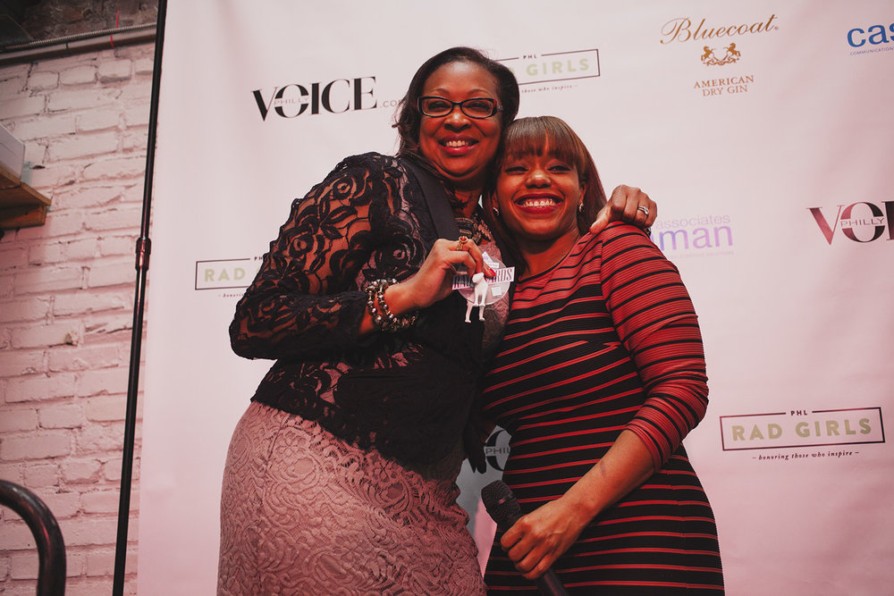 Desiree Peterkin Bell of The Office of Mayor Michael A. Nutter proudly holds her award for Rad Connector of The Year The Rad Awards. Presenter Syreeta Martin stands to her right. April 18. 2015. The Dreaming Building. Chris Fascenelli/Rad-Girls.com.