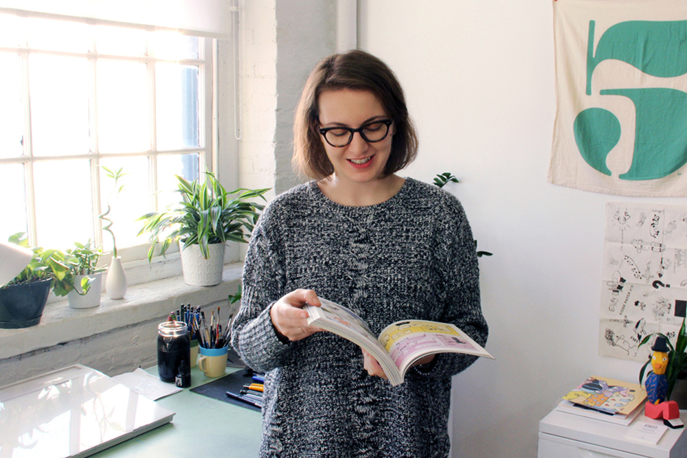 Margherita Urbani browses through Apartamento, a magazine she contributes illustrations to.