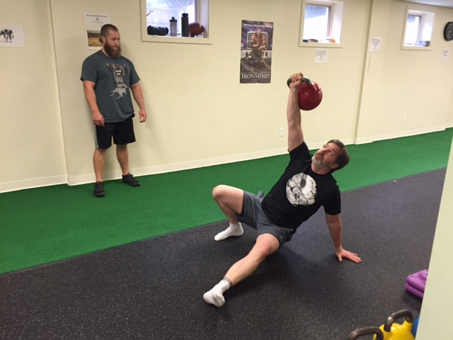 Chris performing a Turkish Get-Up with a 70-lb kettlebell...which is pretty heavy