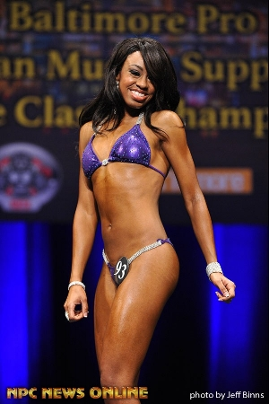 Tiffany posing in her first bikini physique competition last fall
