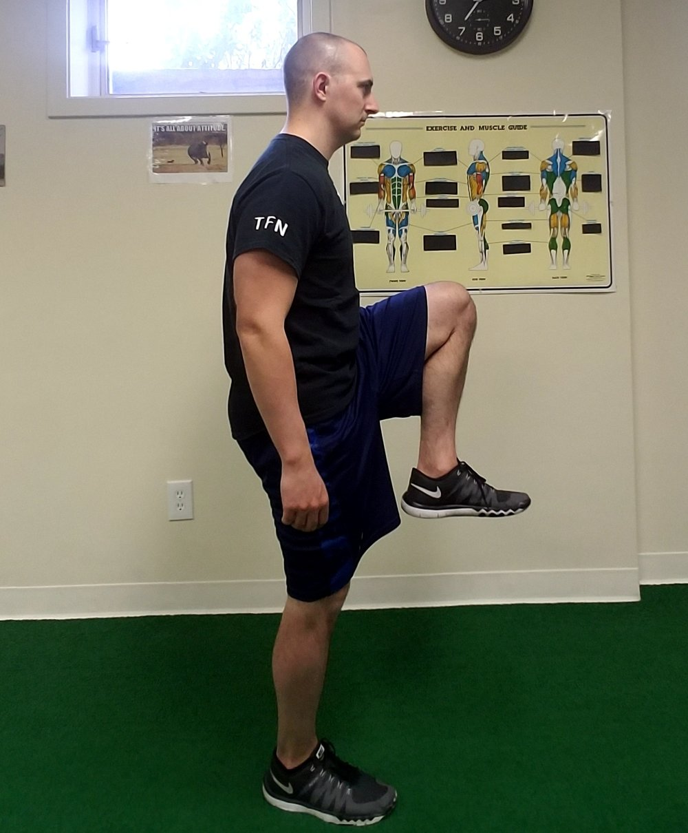 Figure 1.2 In this image, the spine is neutral as set by the core position. When the core musculature is engaged, hip mobility and stability can be fully utilized.