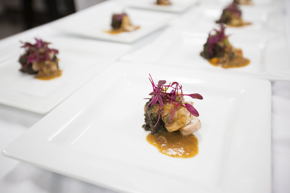Roasted rabbit loin with smoked chorizo, lentils and sauteed carrots and cherry sauce prepared by Chef Keith A. Huffman and Chef Daniel Cleary  on March 19, 2016 in Madison, Wisconsin.