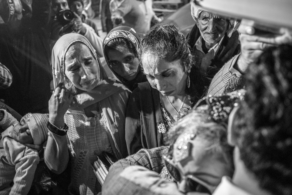 Sarwari Bibi's sisters get emotional while they bid good bye to her after her wedding ceremony on Jan. 7, 2016 in Lahore, Pakistan.
