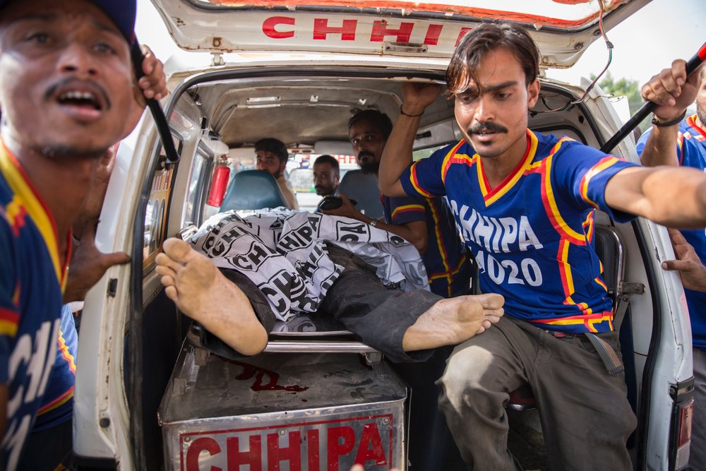 An ambulance arrives at the Jinnah Hospital carrying a dead body of one of the attackers from the Chinese Consulate which was under attack in Karachi, Pakistan, on Nov 22, 2018.