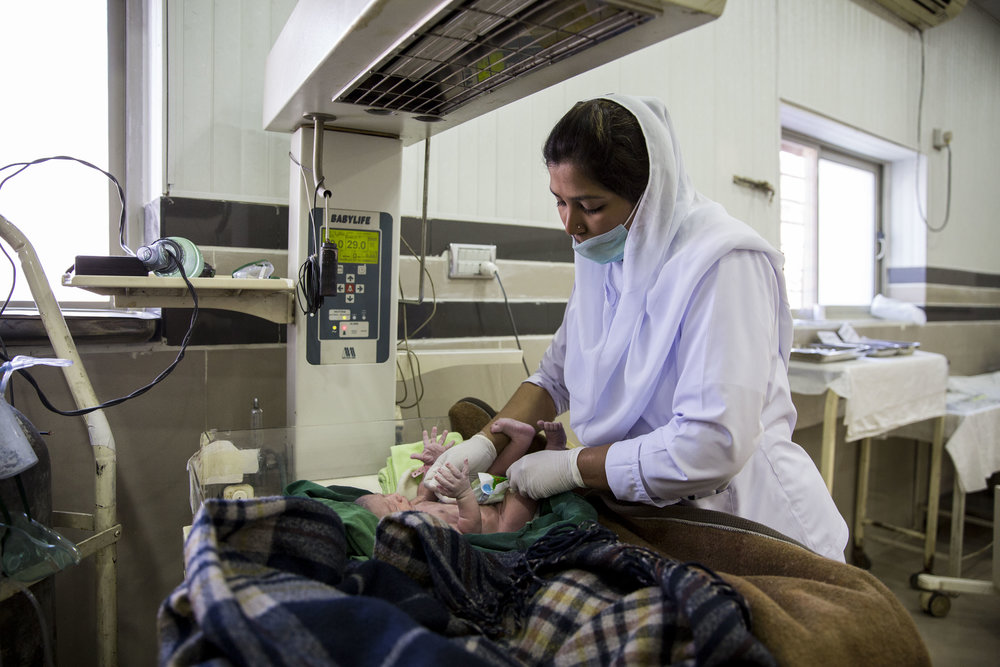Staff Sehar Kanwal clothes a newborn baby inside the labour room.