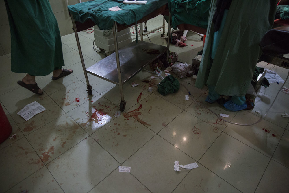 Blood seen on the floor inside the operation theatre as Nosheela has started bleeding again after her C-section was complete.
