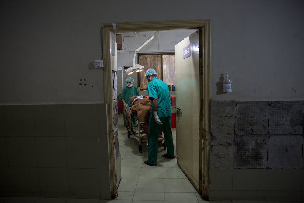 Staff inside the operation theatre prepares to move Nosheela to the high dependency unit after her surgery.