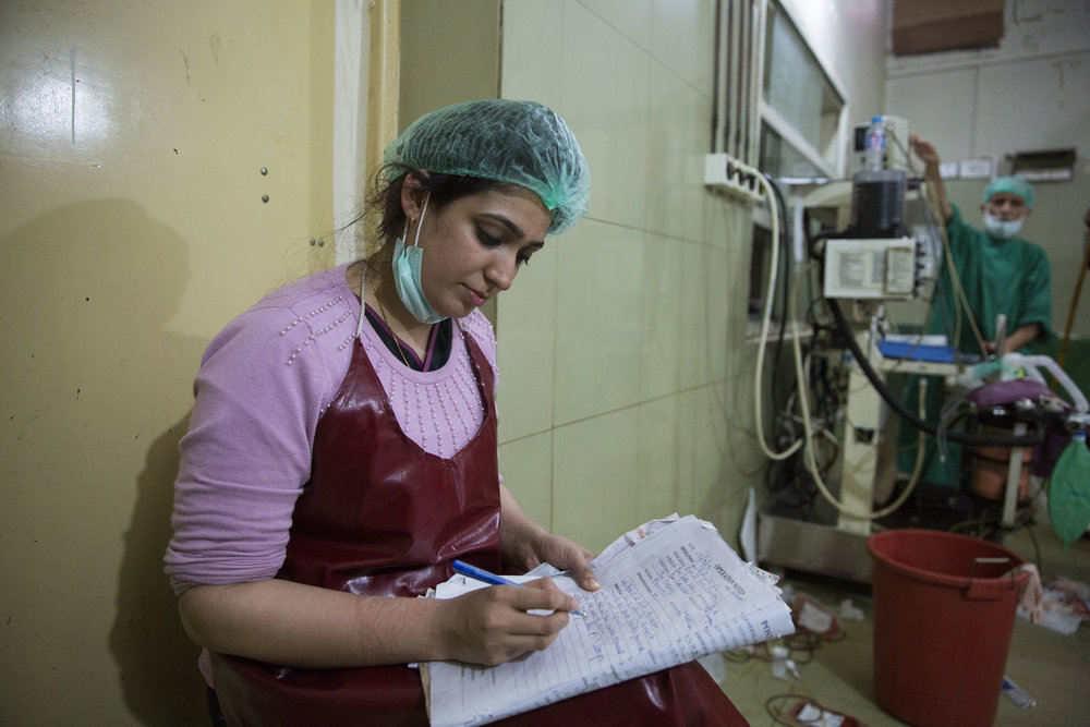 Trainee Dr. Mubaraka Hussain takes notes after Nosheela's surgery who was given multiple doses of Tranxamin during her C-section.