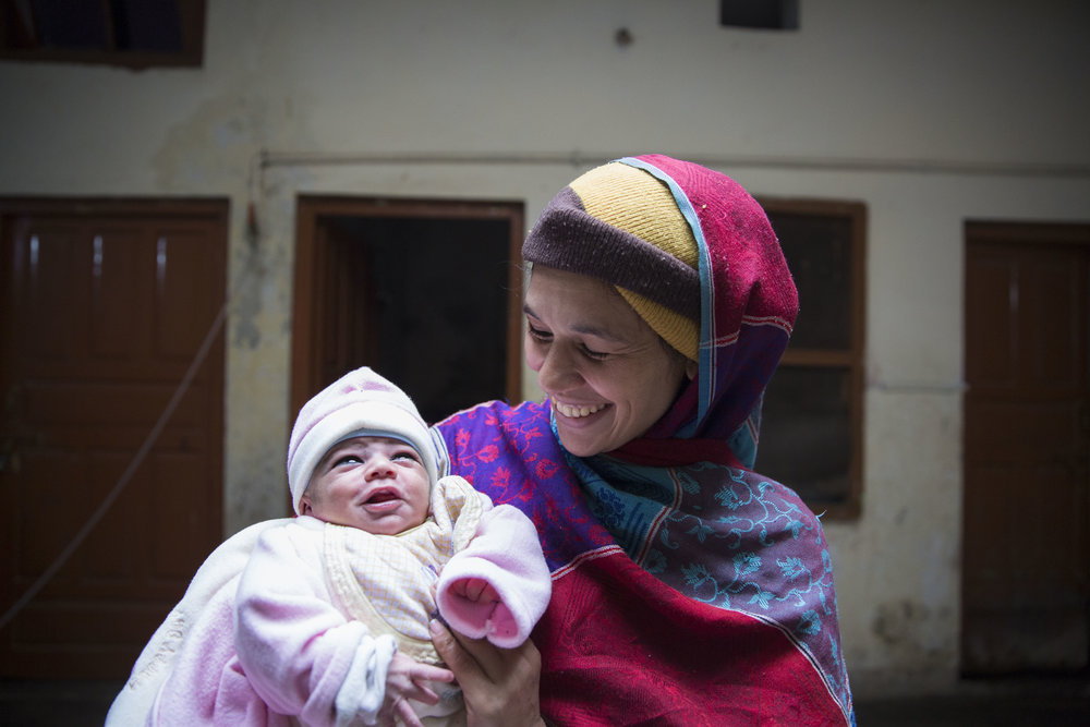 Sobia Sajid along with her newly born baby Ahmed Sajid at their residence after nine days since her delivery where she suffered from postpartum haemorrhaging.