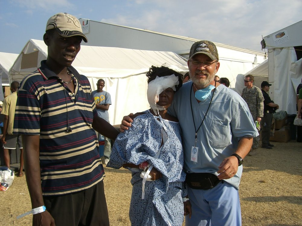 Kurt Holthus providing compassion to Haitian couple