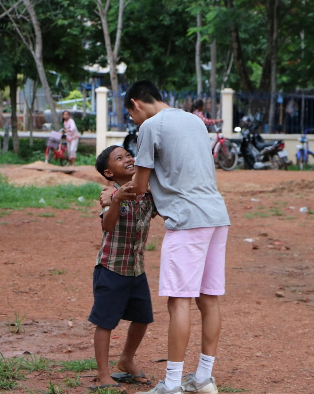 Derek Chiang and a student of the Banan TASSEL School, summer 2016.