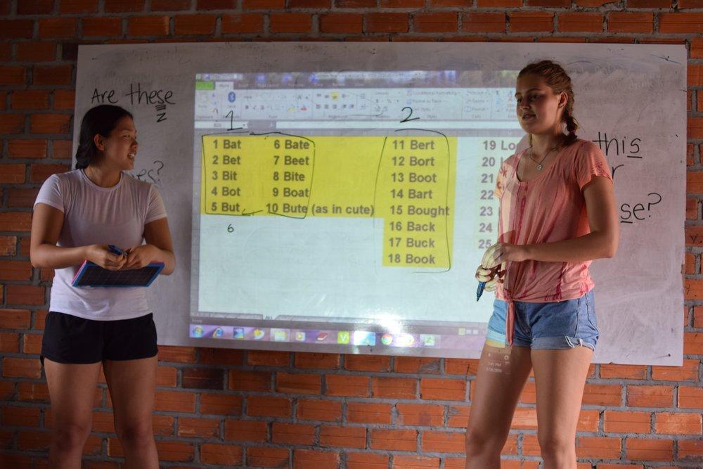 Sophia Lee (left) teaching at the Samrang TASSEL School during a summer 2016 TASSEL trip.