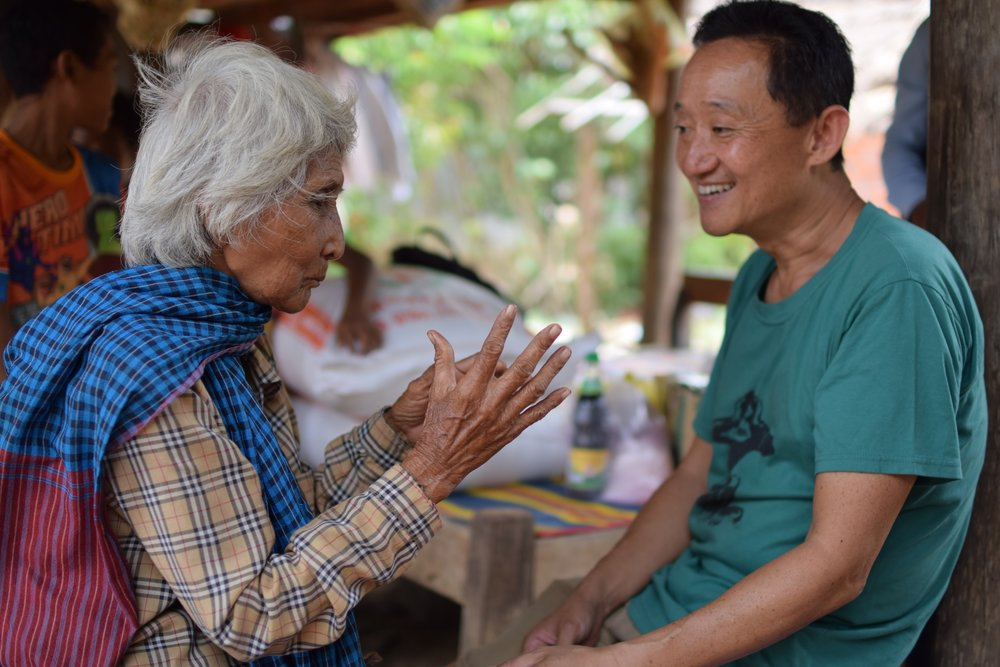 TASSEL founder Joji Tatsugi visiting a local family, 2016.